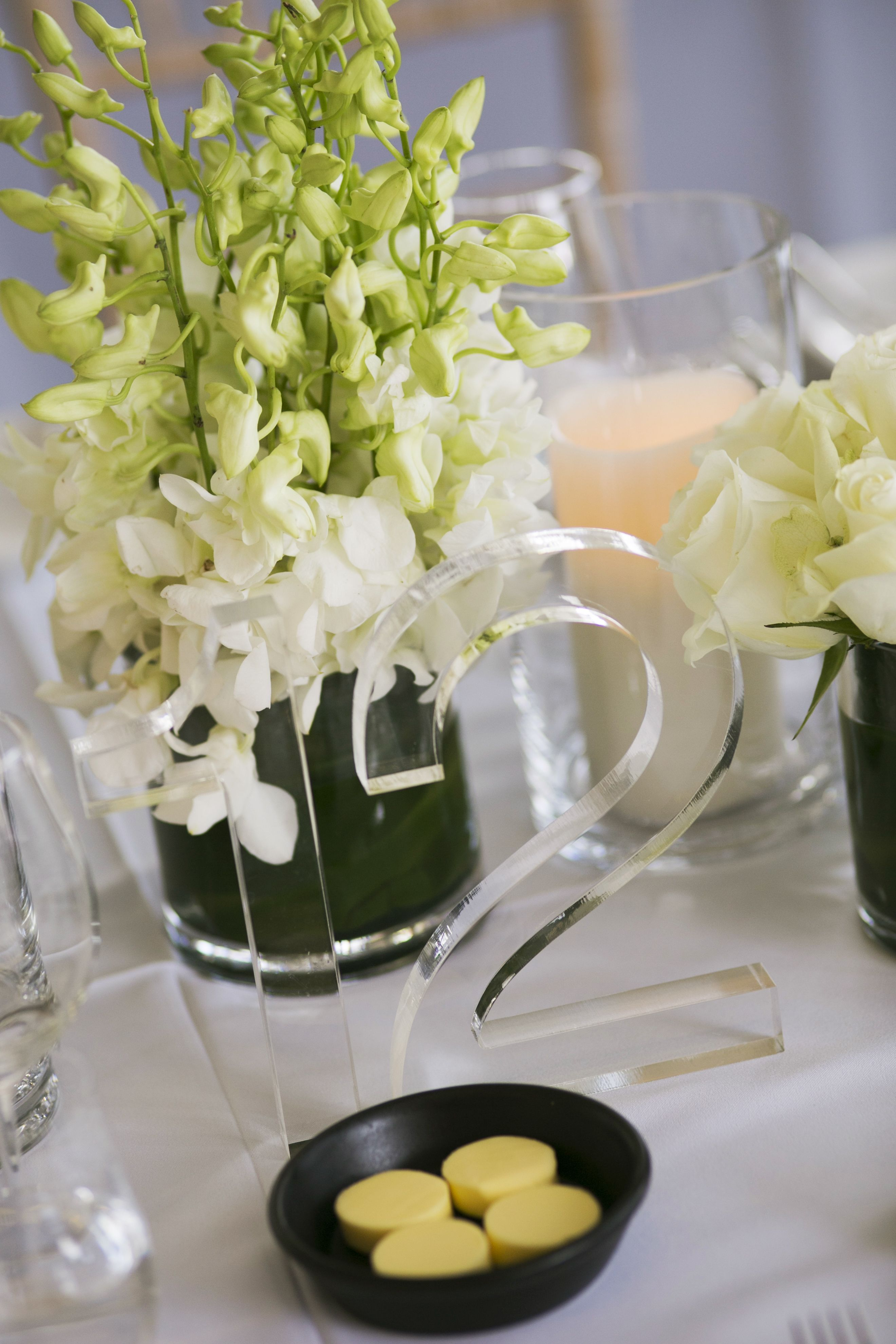 White and green wedding table setting ideas - Glass wedding table number | itakeyou.co.uk