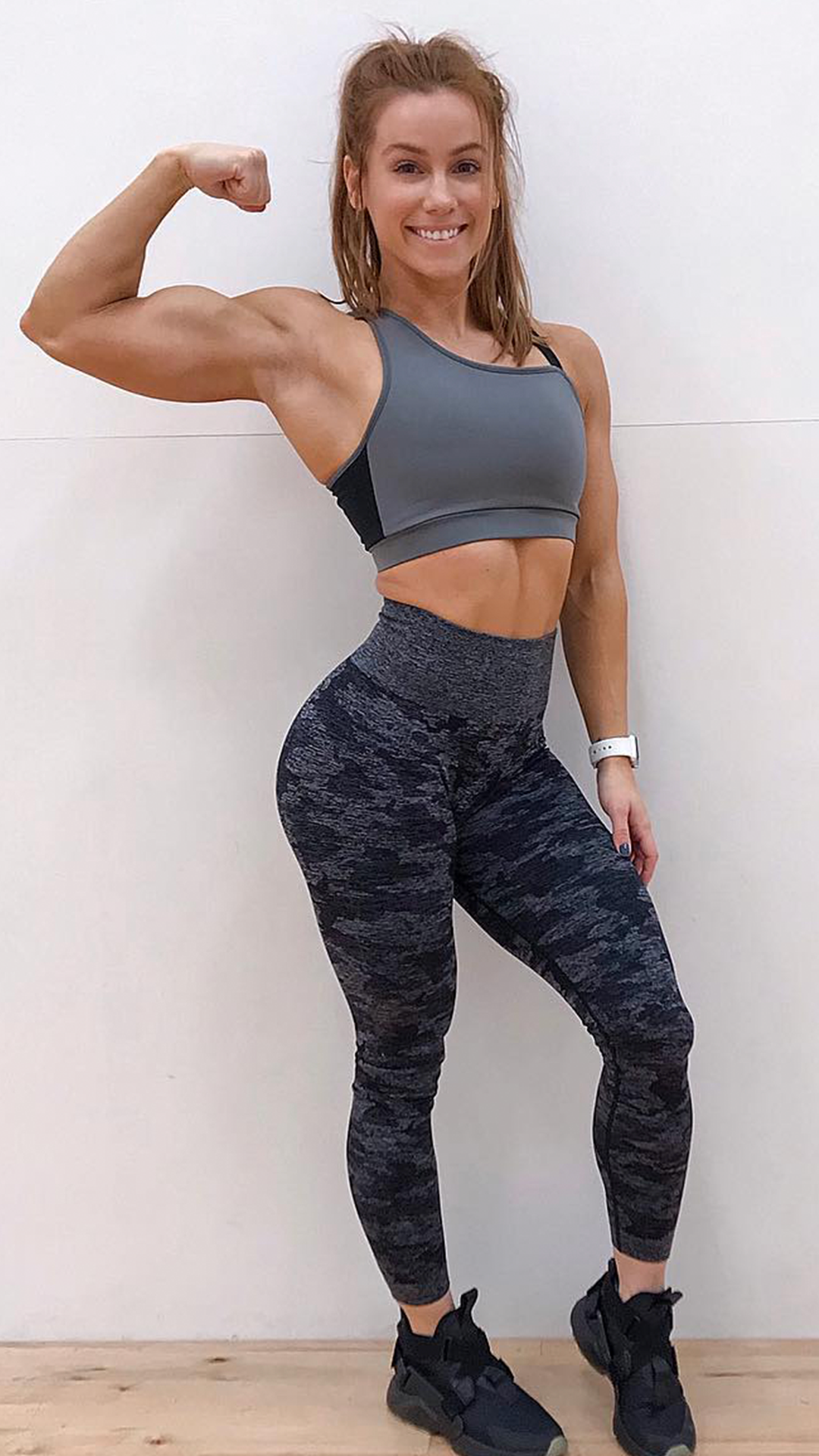 352e832aa68b88 Lauren Findley, Gymshark Athlete mixes and matches the Camo Seamless  Leggings with the Asymmetric Sports Bra. A cool, contemporary look for your  workouts!