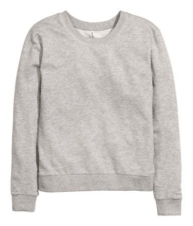 Long-sleeved top in sweatshirt fabric with ribbing at the cuffs and hem.