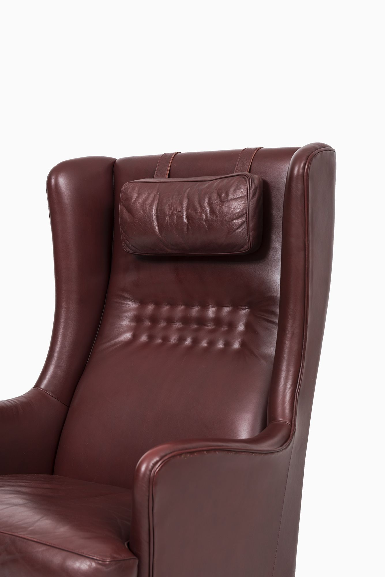 Arne Norell wingback easy chair in dark red leather at Studio Schalling