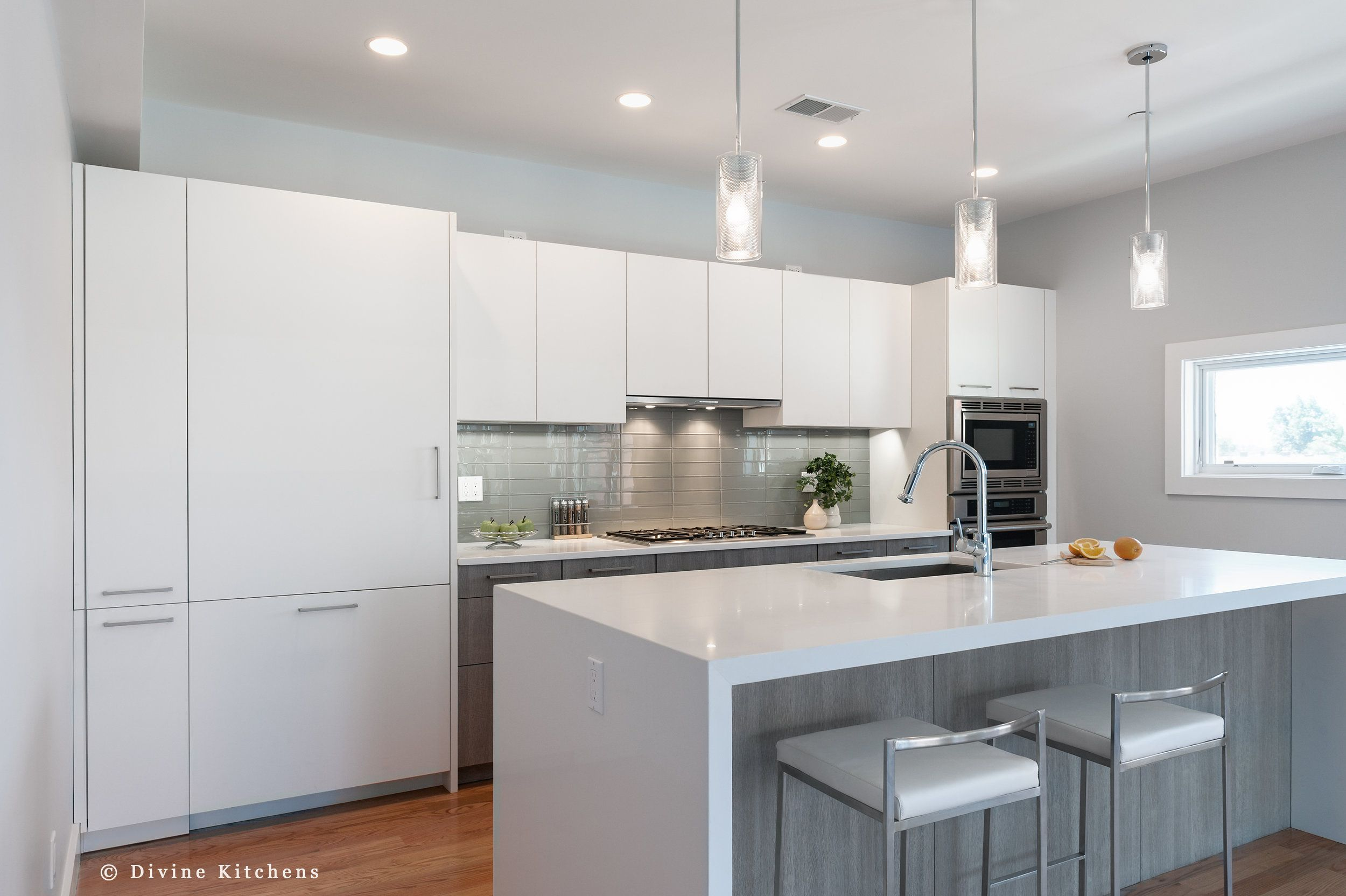 Modern Kitchen With Matt White Flat Panel Cabinets And Cambria Countert Kitchen Cabinets Grey And White White Modern Kitchen Grey Kitchen Walls White Cabinets