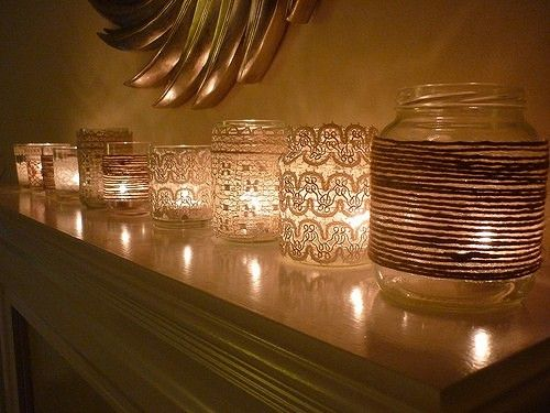 Glass vases/jars with wrapped in lace or twine with candles glowing inside? Maybe pretty for the outdoor tables? I thought Roger might like the twine.