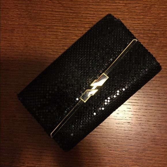 Black Sequined Clutch Lovely sparkly black clutch will dress up any outfit. Loads of interior pockets make it easy to organize your evening touch-up products. Bags Clutches & Wristlets
