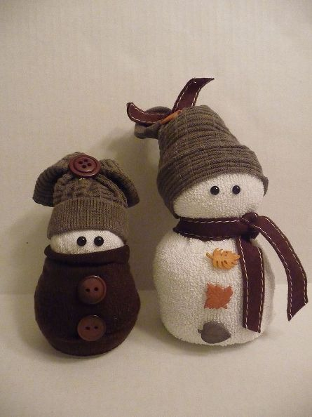 sock snowmen or snow babies as i like to call them, crafts, seasonal holiday decor, These two are made entirely of beans It makes them really heavy but they won t fall over I used fall colors for them They really can be left out all season