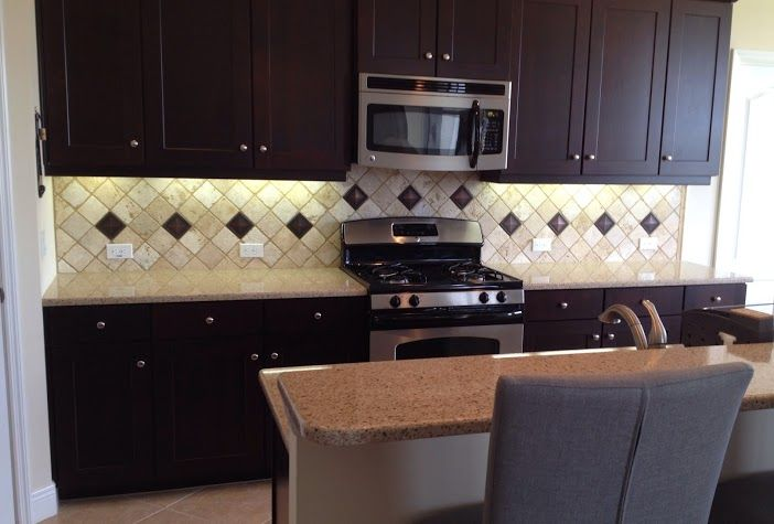 Finished The Diagonal 4x4 Tumbled Chiaro Backsplash W Resin Accents In Bradenton Fl Backsplash Tile Chiaro Travertine Lakewoo Home Decor Tiles Tile Work