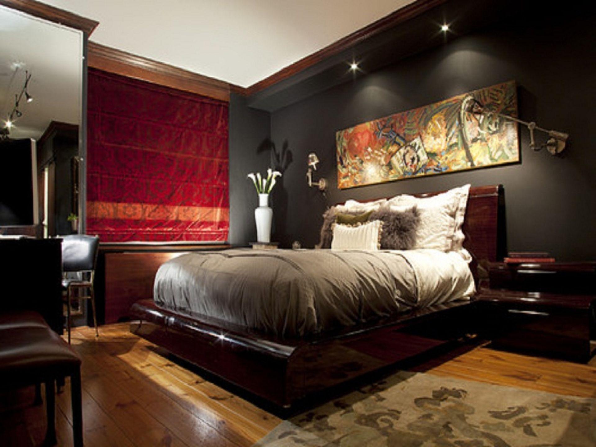 Exotic men bedroom design ideas with wooden floor and dark walls