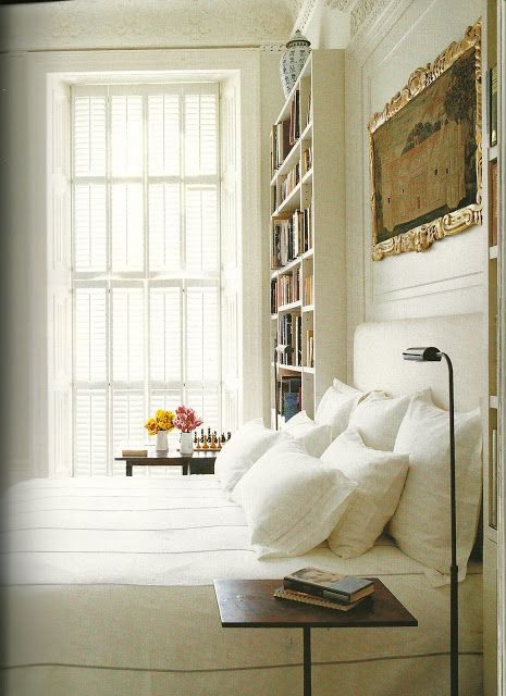 Jasper Conran's flat by Ann Boyd. Bookshelves within panelling.