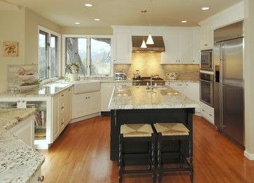 white spring granite with white cabinets and black island