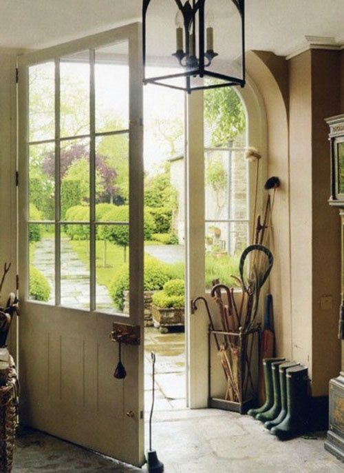 THEFULLERVIEW. Beautiful mud room entry, half panelled wood door, off white, stone floors