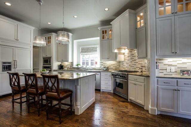 Pretty kitchen with beautiful backdrop and dark hardwood floors.