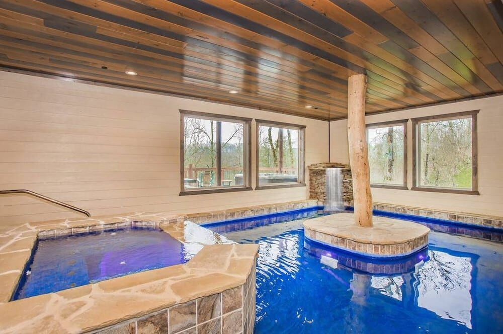 4 Incredible Gatlinburg Cabins With Indoor Pools And Home Theaters With Images Indoor Hot Tub Hot Tub Outdoor Gatlinburg Cabins