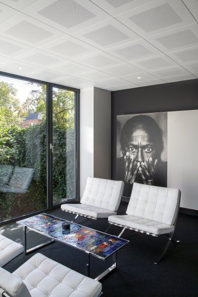 Office Lounge With White Barcelona Chairs By Mies Van Der Rohe Lit