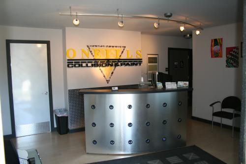 Lobby Renovation - This professional auto body shop was renovated with a new build out and paint job to finish off their modern look and style.