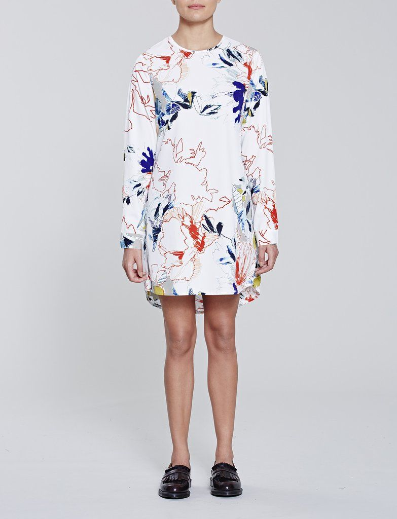 Native Youth Unfinished Floral Dress in lightweight white fabrics with an  unfinished floral design.