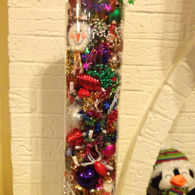 Large Vase Filled With Christmas Ornaments And Garland That Is No
