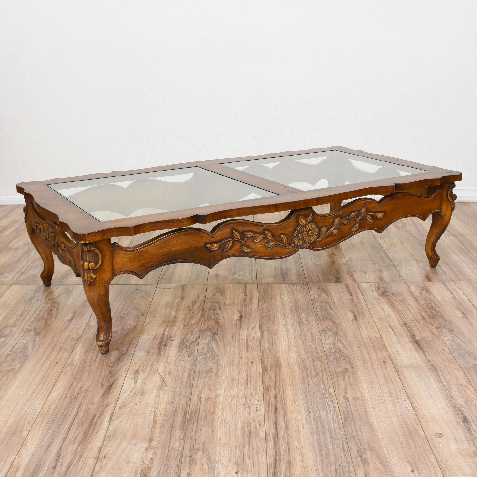"This ""Karges"" coffee table is featured in a solid wood with a"