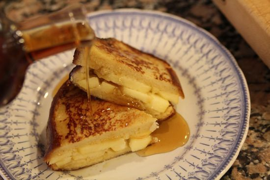 Boule bread french toasted with home made cream cheese and apple slices. Topped with maple syrup.