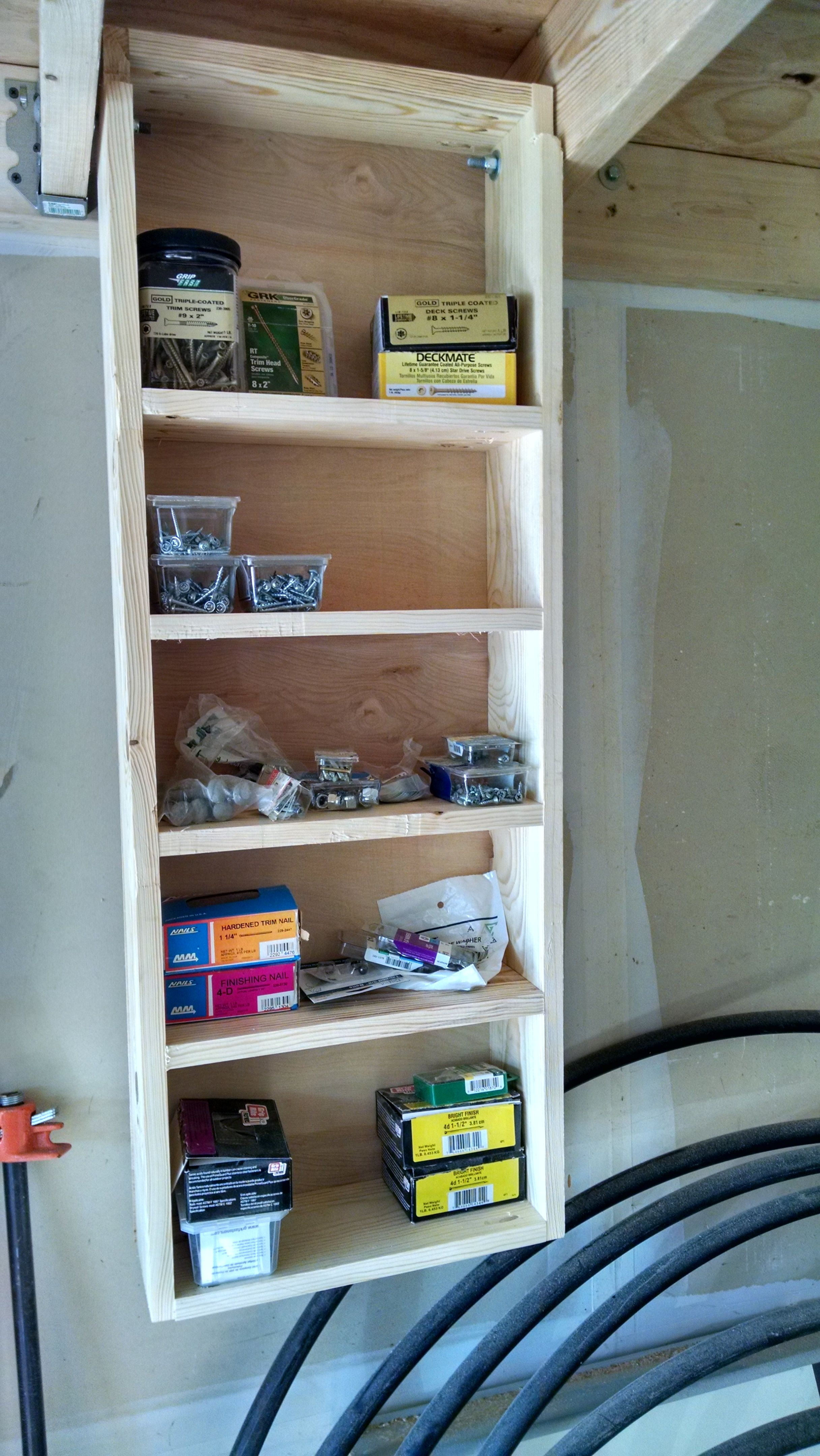 Garage Storage Solution A Fold Down Up Shelf That Folds Into The Rafters Garage Storage Organization Garage Storage Garage Storage Cabinets