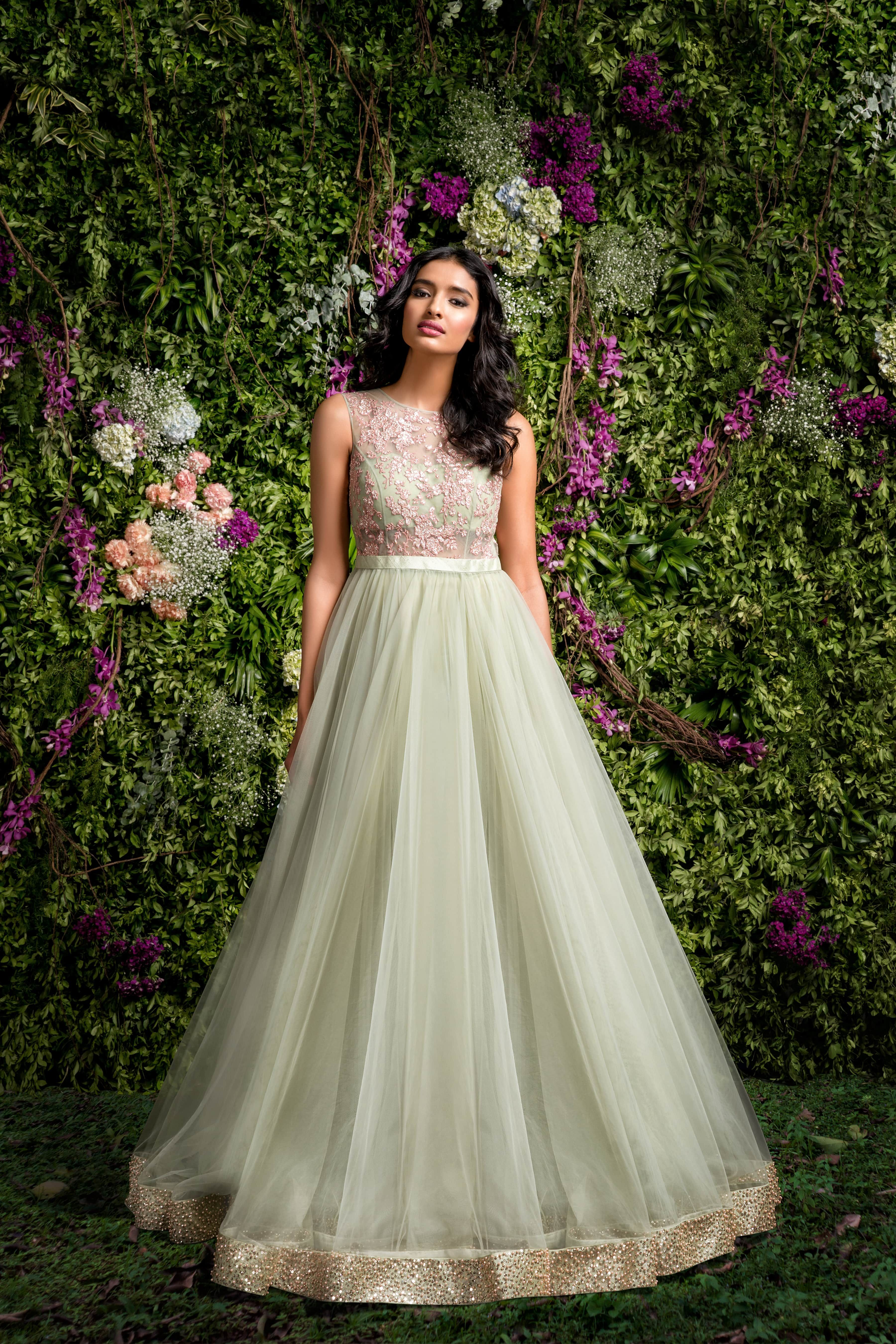 A Subdued Green gown with a tulle flare and fitted bodice