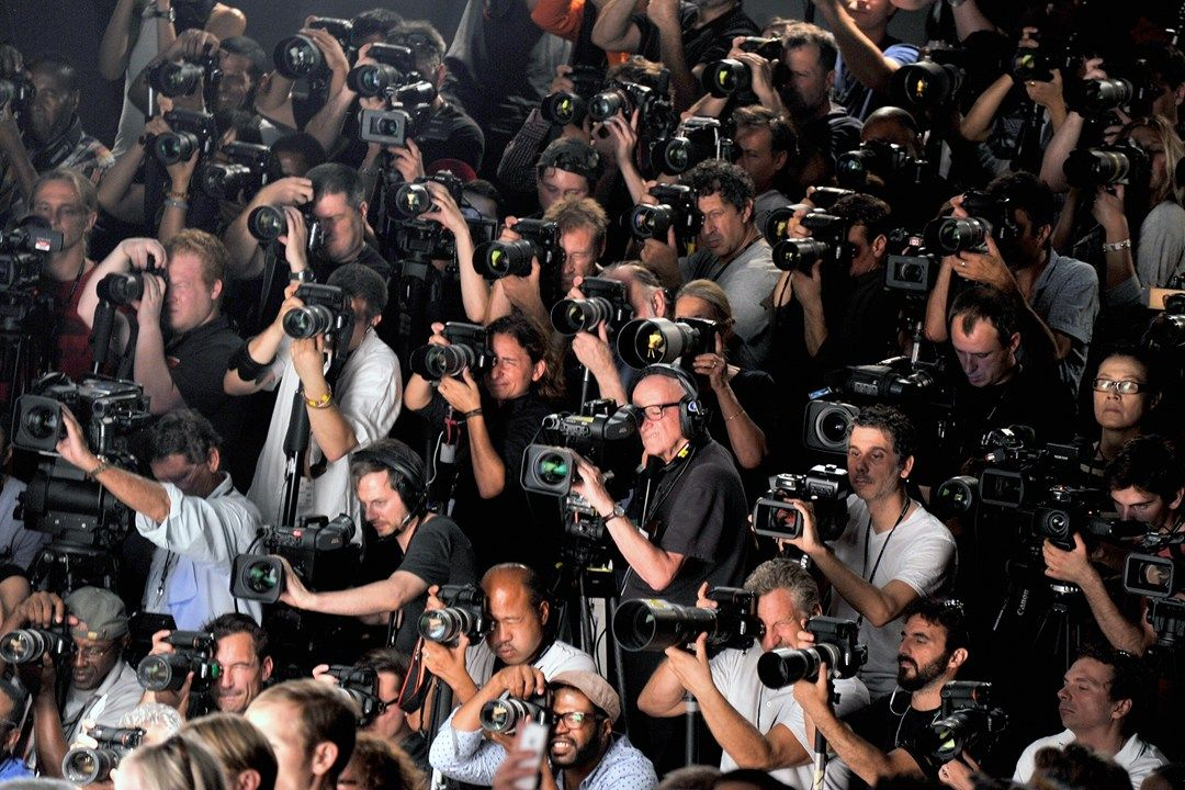September 11  Photographers gather at the end of the J. Mendel catwalk in New York.