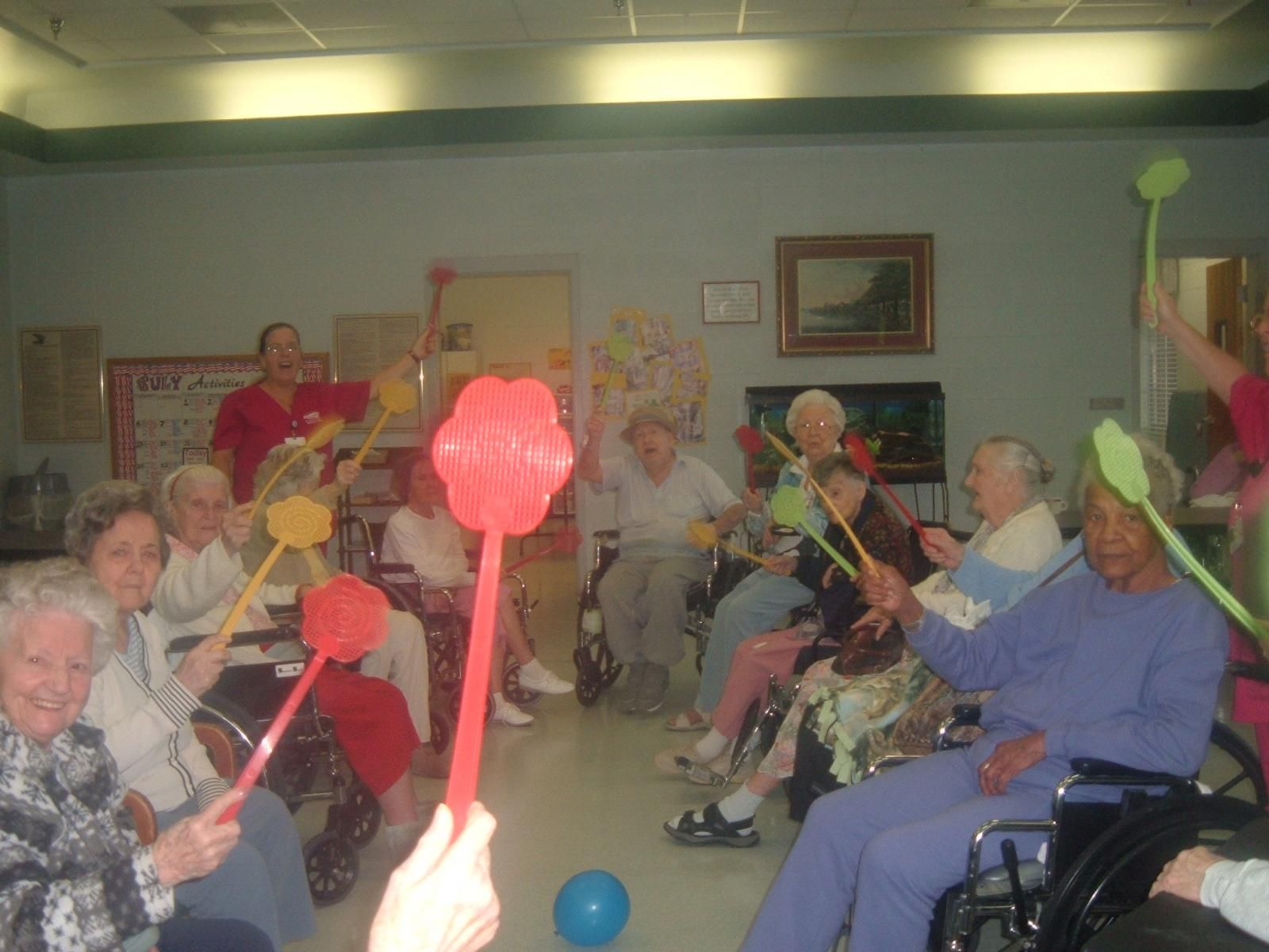 Flyball Fun Game For Residents Using Flyswatters And Balloons A
