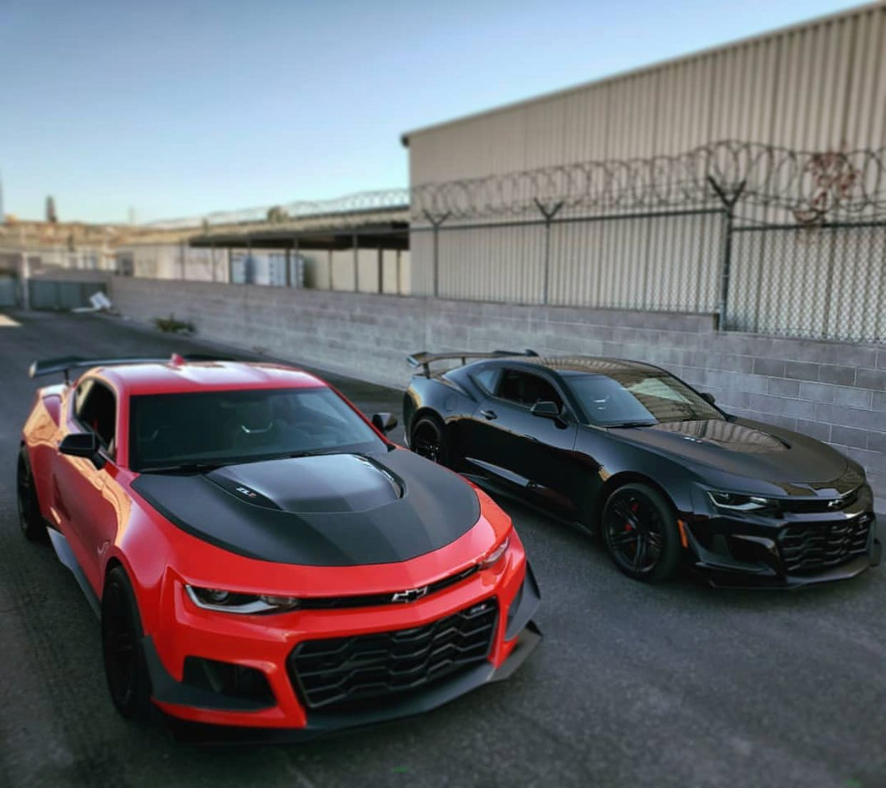 Two Chevrolet Camaro Zl1 1le S Painted In Red Hot And Black Photo