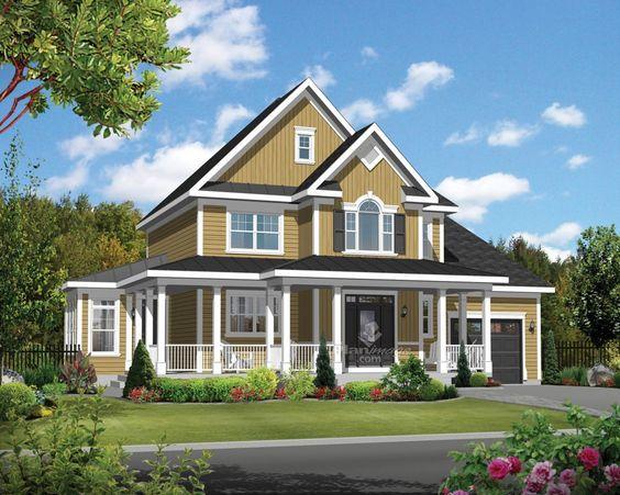 Une grande véranda entoure la façade de cette maison à étage de