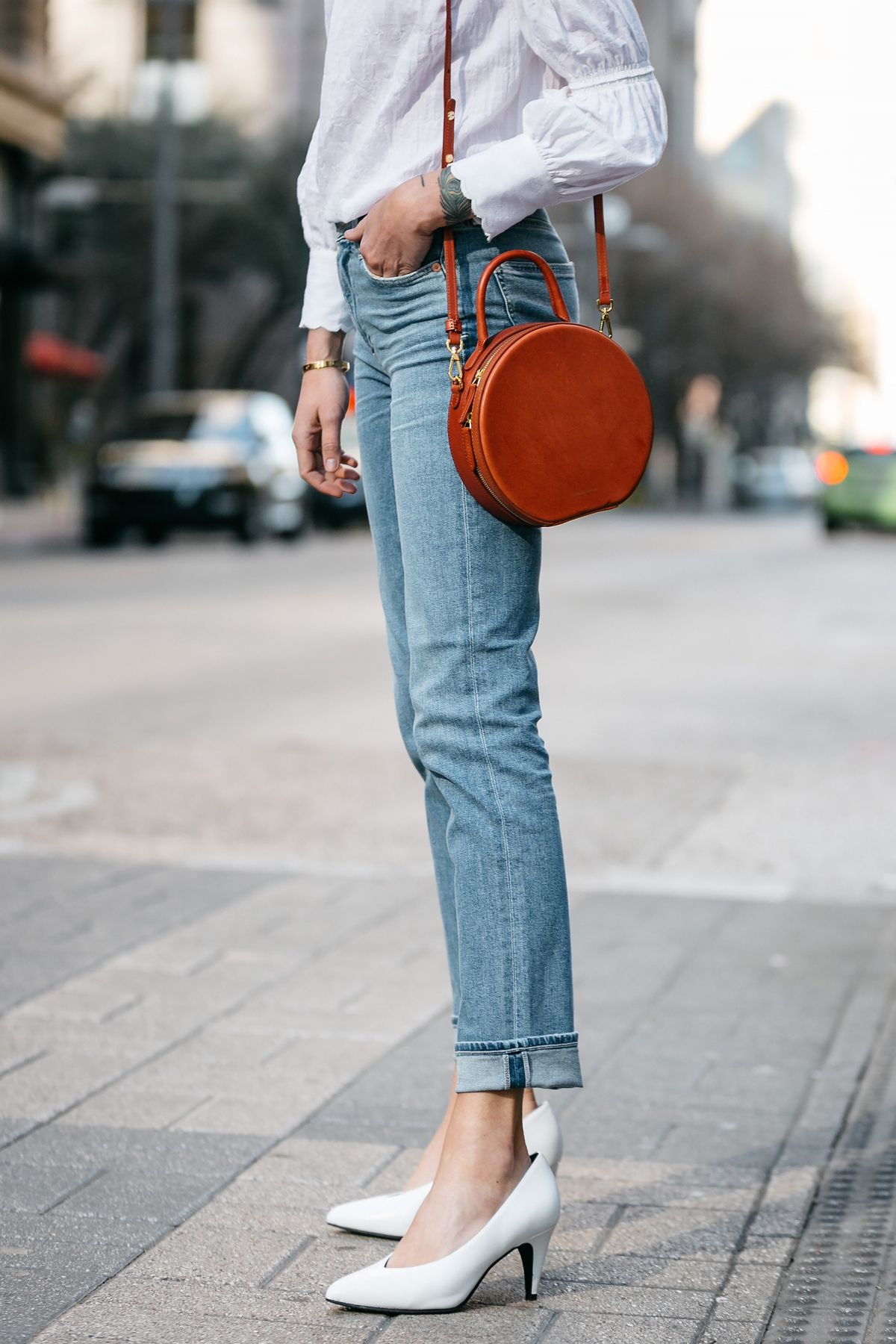 superior performance best selling so cheap Woman Wearing Relaxed Denim Jeans Mansur Gavriel Circle Bag ...