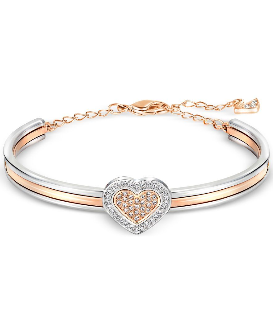 Polish your look with love when you wear this captivating two-tone crystal heart  bangle bracelet fashioned by Swarovski in rose gold-tone in silver-tone ... 04254ca97a93
