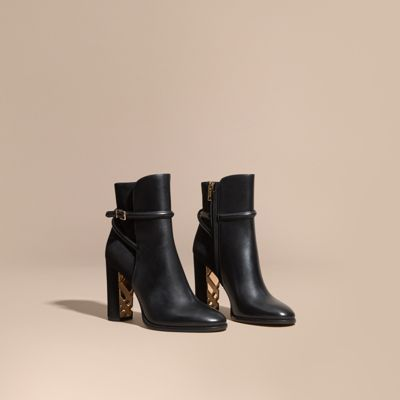 31faf942cf40 All-occasion ankle boots with a slim wraparound belt. Panels of smooth  leather…