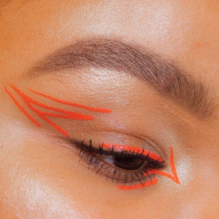 Photo of Neon orange eyeliner makeup