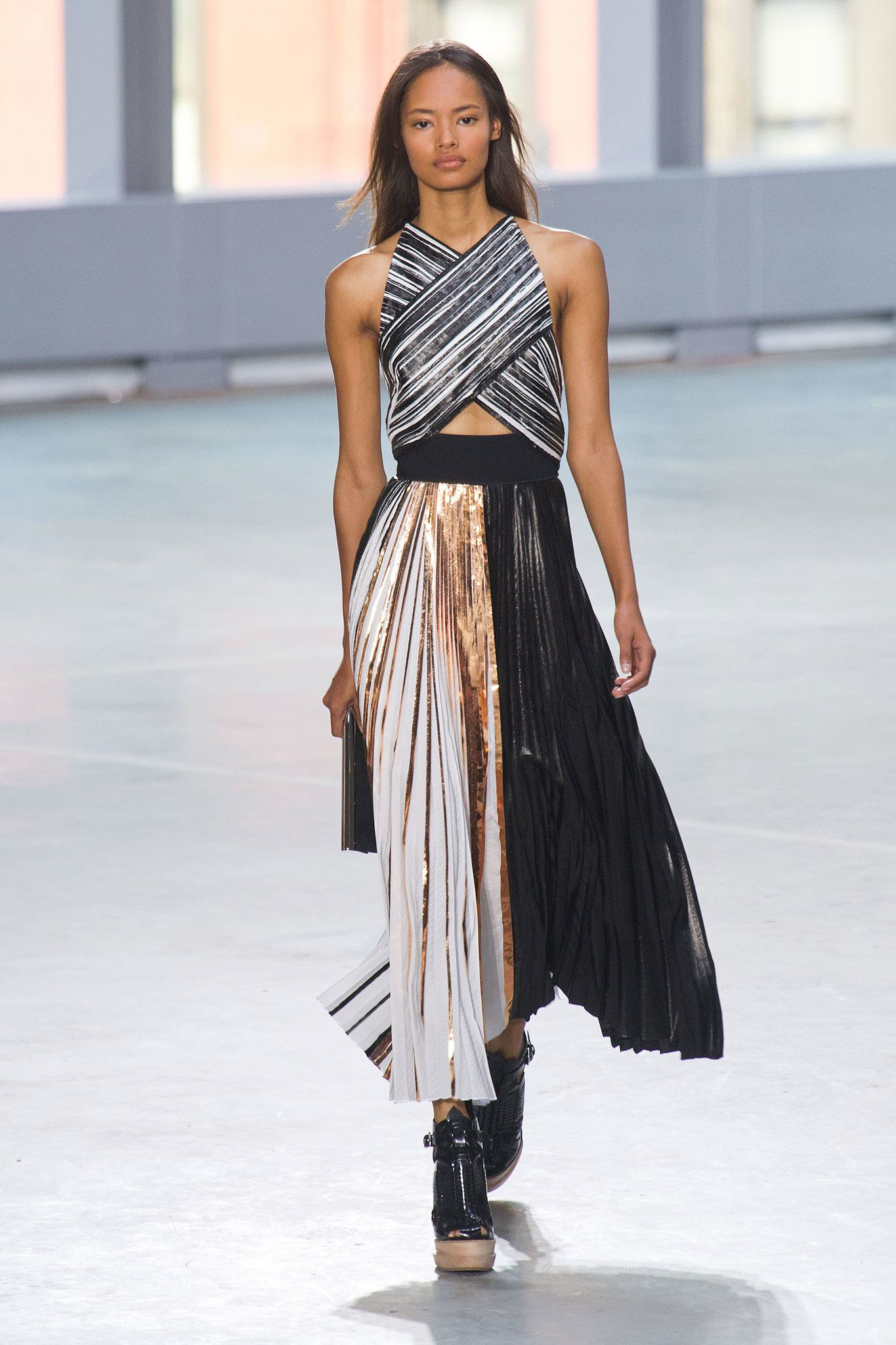 And where buttons or fur didn't do the talking, the designers let strips of shiny metallic fabric help their clothes capture attention.