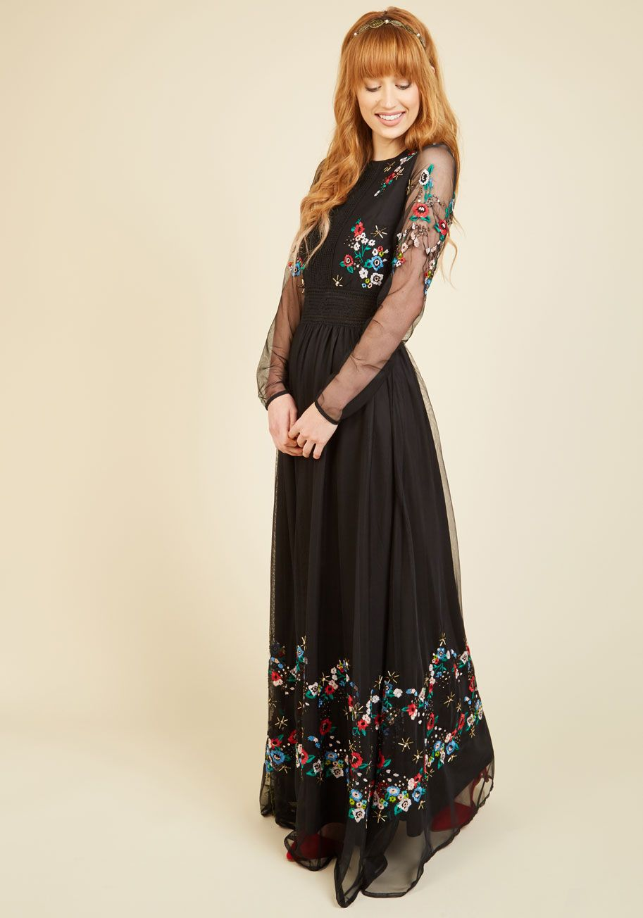 c59ee676959b Mingling crocheted bodice accents with a buttoned open back, this black maxi  dress revolutionizes rustic style! Its long-sleeved silhouette is infused  with ...