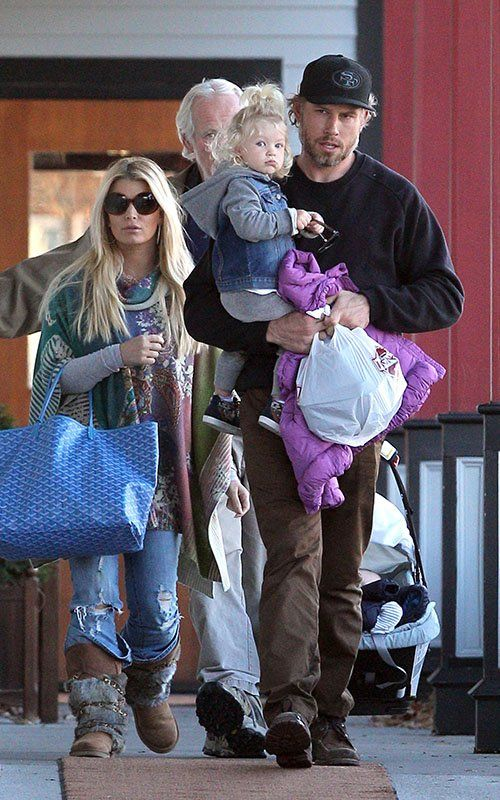 Jessica Simpson wearing Australia Luxe Collective Rabbit Atilla Fur Boots  in Chestnut Goyard Large St Louis Tote Bag in Blue 47acfe36805