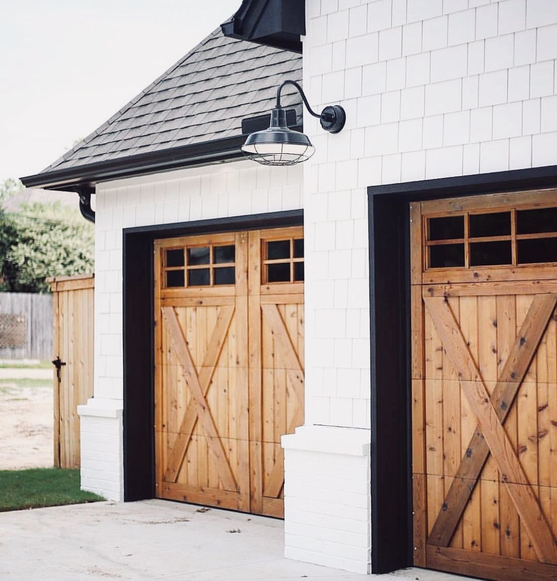 Wood Rustic Farmhouse Garage Doors White Siding Black Roof Garage Door Design Farmhouse Exterior Dream House Exterior