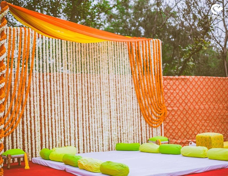 Outdoor Venue Decorated With Marigold Strings Drapes And Bolsters