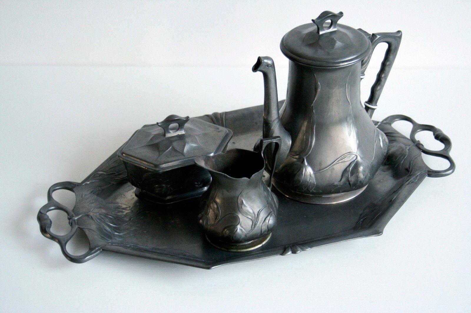 Jugendstil zinn Kaffee Set von Orivit FOR SALE • EUR 295,00 • See Photos! Money Back Guarantee. Jugendstil Kaffee Set aus zinn in gutem gebrauchten zustand mit kleine altersspuren (siehe bilder) manufaktur: Orivit Metallwarenfabrik (Köln) produziert um 1900 - 1910 tablett 46 x 28 cm, höhe kaffeekanne 232155315712
