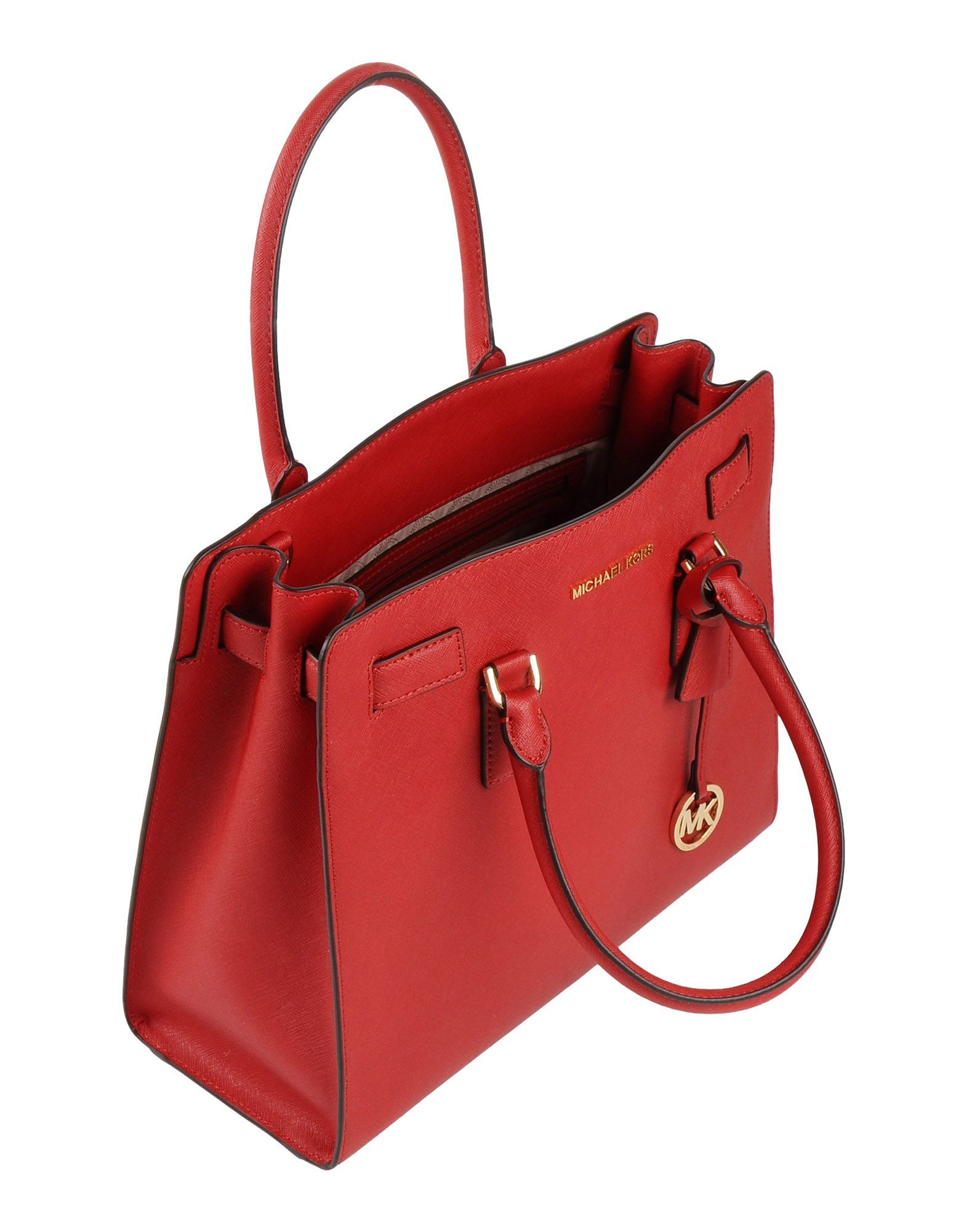 To give that outfit a pop of color - Michael Kors bag