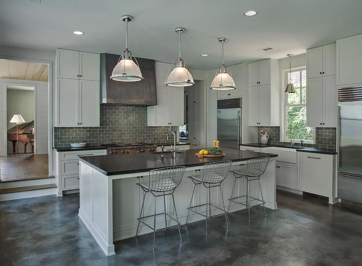 Gray industrial kitchen features light gray cabinets for Gray kitchen cabinets with black counter