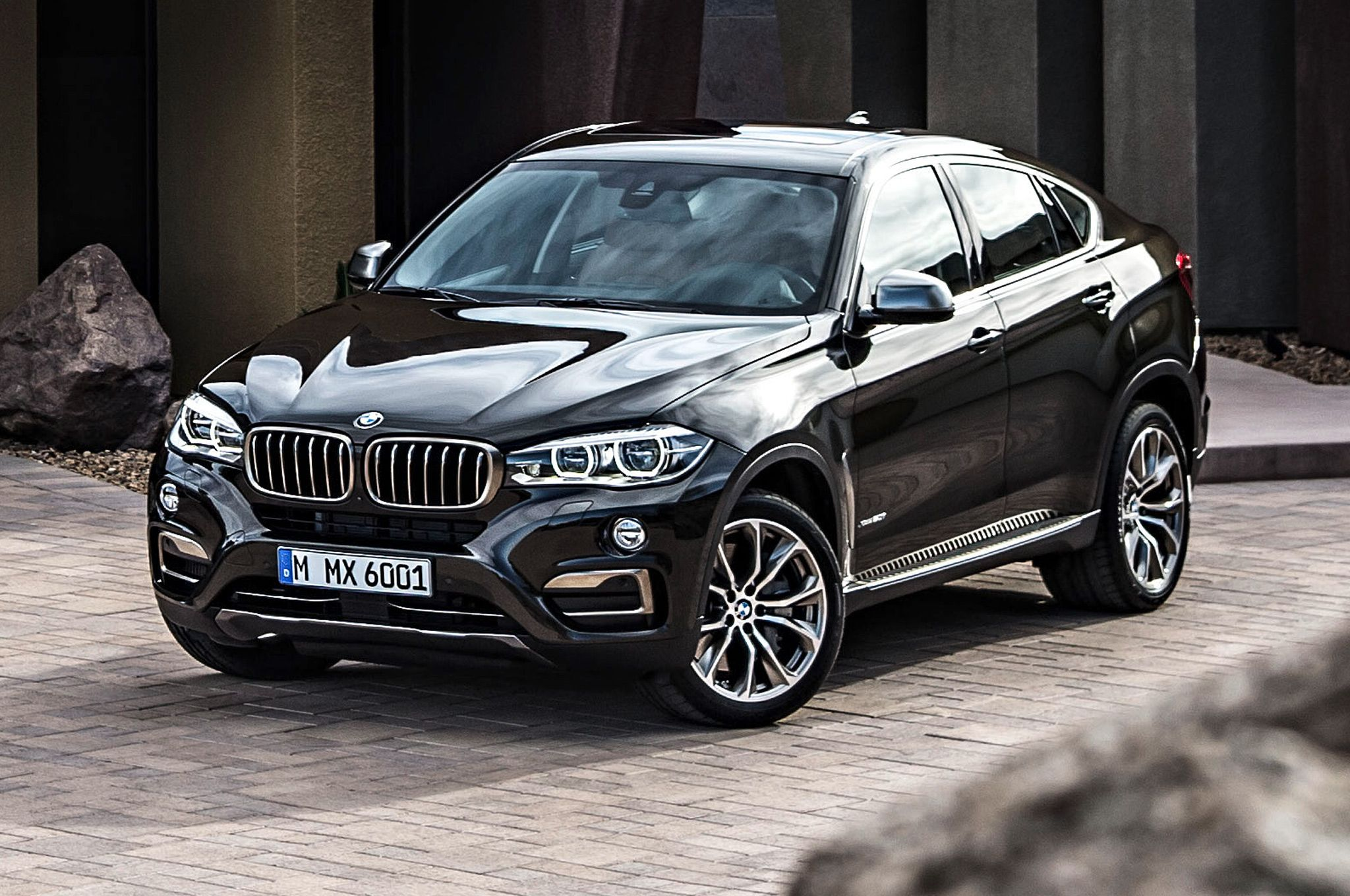 2015 bmw x6 front side view in driveway