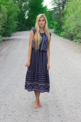 The Gemma Blue Midi Dress. This dress is so modest and so cute with the cinched waist detail. Shop Nelipot Apparel Now!