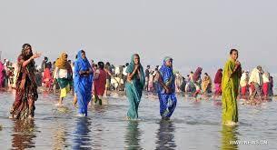 Image result for indian women bathing in kumbh mela