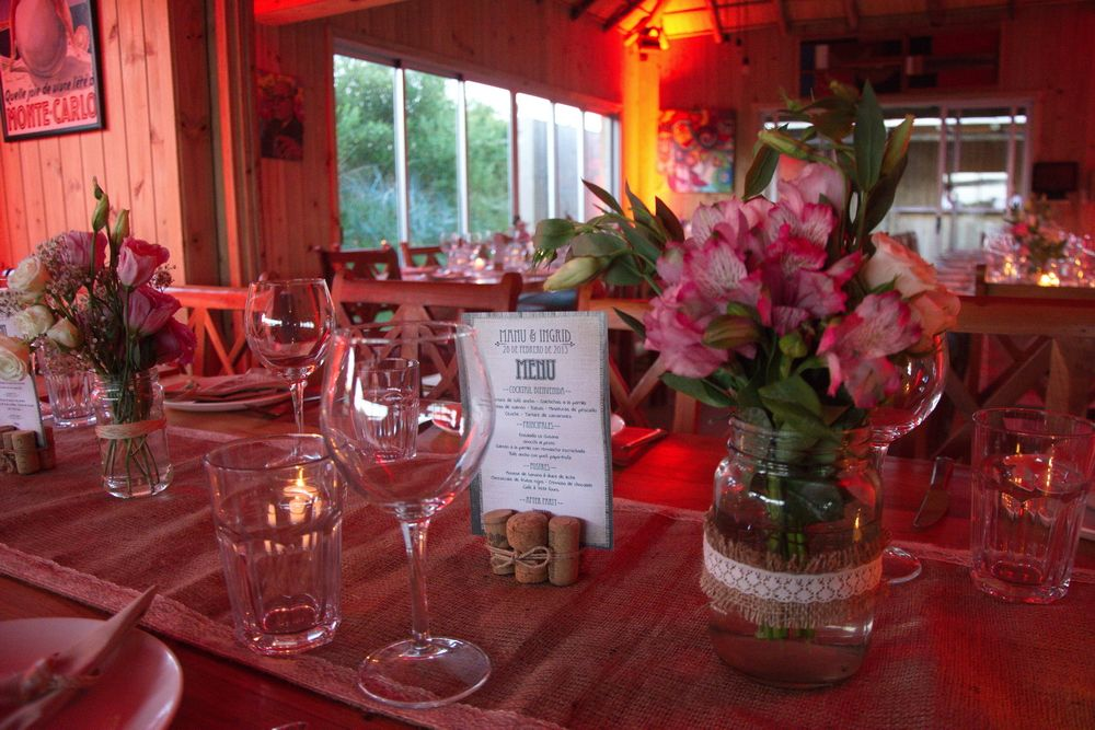 Table centerpieces with flowers candles and rustic