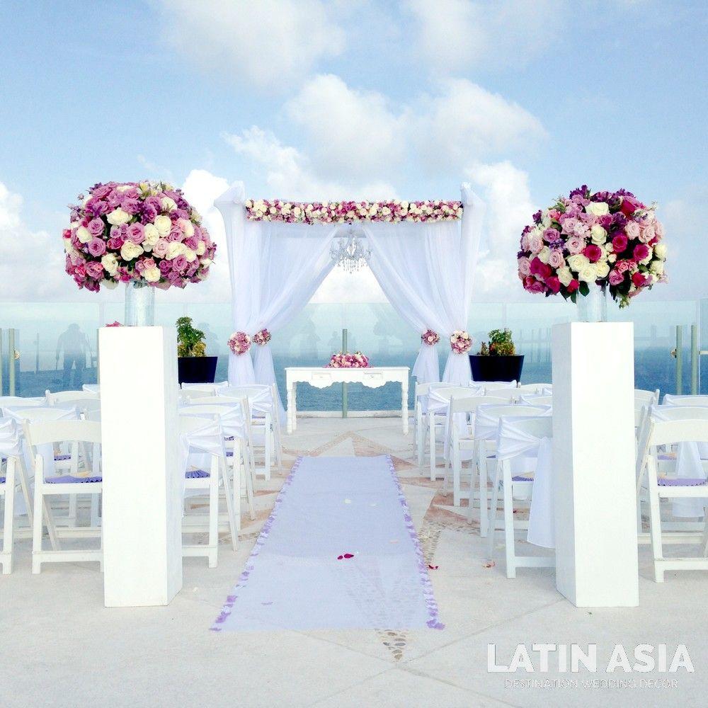 purple aisle decor by weddingcancun