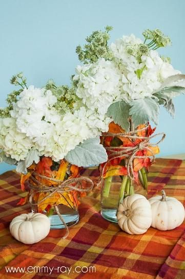 20 DIY Thanksgiving crafts to decorate your table - floral vases decorated with fall leaves and twine