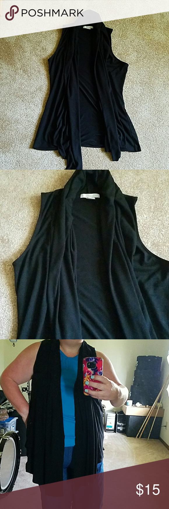Sleeveless long jacket/vest. I wear a 1 x or 18 and this fits me fine. Small amount of piling under arms. Long and flowing.  Good used condition.  Bundle up and save Charlotte Russe Jackets & Coats Vests