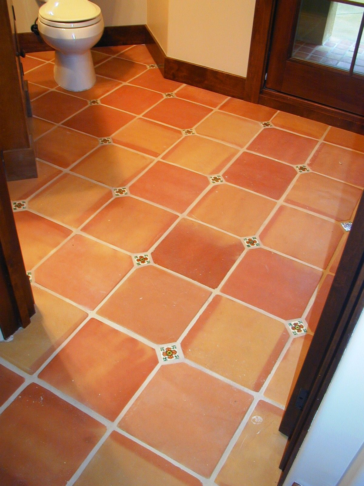 12x12 traditional terra cotta tiles with a 2x2 insert cut Spanish clay tile