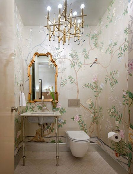 wallpapered half bathroom with chandelier gilt mirror Is that