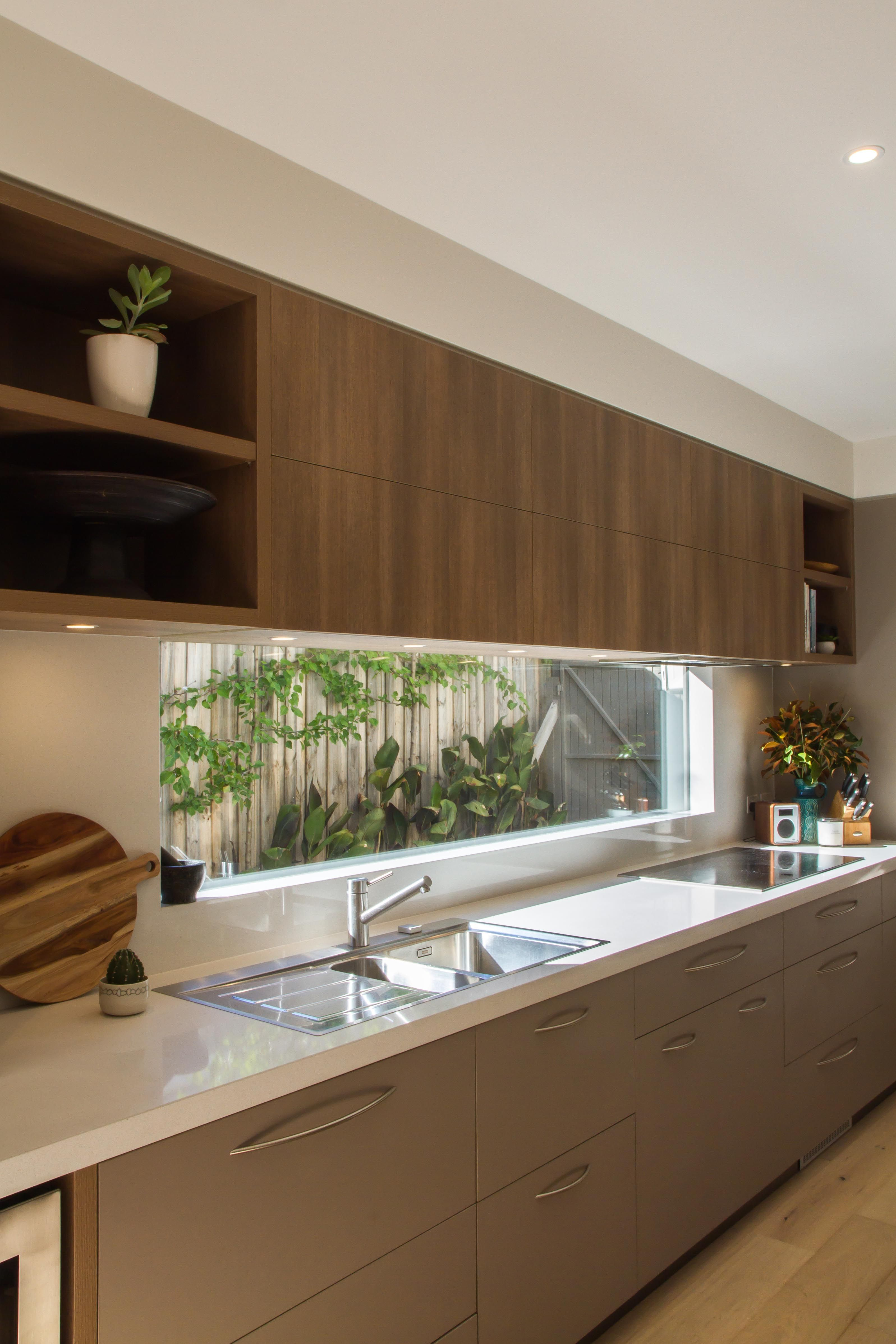Large, modern, contemporary kitchen in warm tones with a huge island ...