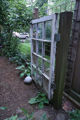 Garden gate - use an old window with glass removed, and hinge onto a